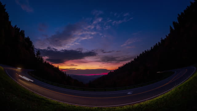 Time lapse shot of cars moving along a highway at dusk in the Great Smoky Mountains National Park.