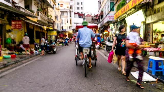 Time lapse shot of city and traffic on Cyclo tricycle in Hanoi city, Vietnam
