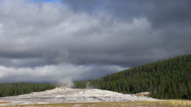 time lapse shot of clouds and geyser of yellowstone national park - yellowstone national park stock videos & royalty-free footage