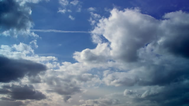time lapse shot of clouds drifting across the sky. - cloudscape stock videos & royalty-free footage
