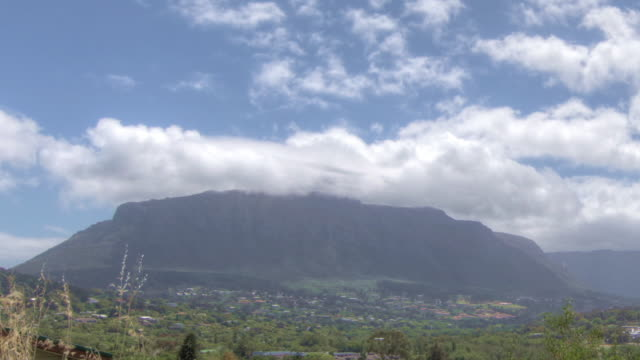 Time lapse shot of clouds drifting over Table Mountain and the outskirts of Cape Town.