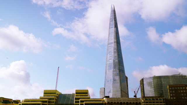 time lapse shot of clouds drifting past the shard. - shard london bridge stock videos & royalty-free footage