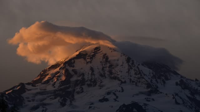 time lapse shot of cloudscape over snowcapped mountain at mount rainier national park - mt rainier national park stock videos & royalty-free footage