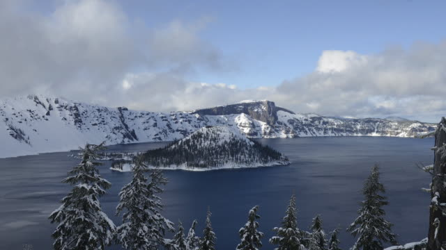 time lapse shot of crater lake against cloudy sky at national park - crater lake oregon stock videos & royalty-free footage