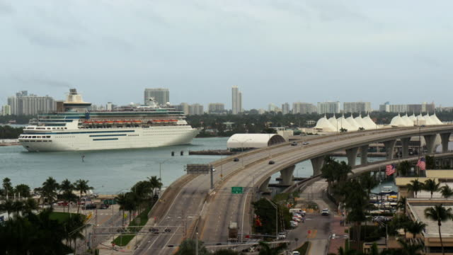 time lapse shot of cruise ship arriving port miami at daytime - spoonfilm stock-videos und b-roll-filmmaterial