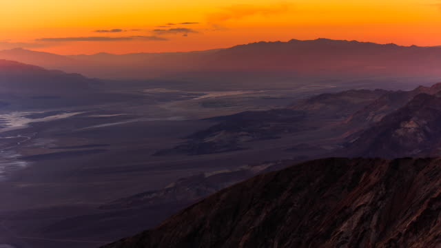 time lapse shot of dawn breaking over death valley. - death valley national park stock videos & royalty-free footage