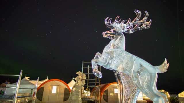 time lapse shot of elk ice sculpture at famous park against sky - northwest territories, canada - fast motion stock videos & royalty-free footage