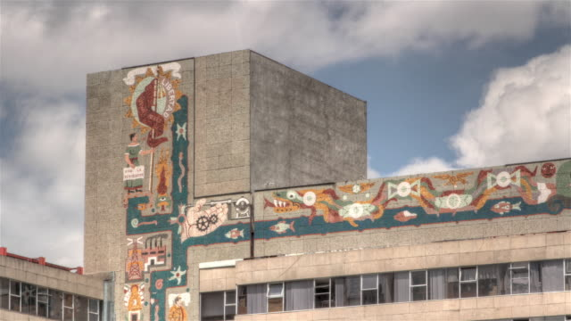 Time lapse shot of graffiti on the side of a building in Mexico City.