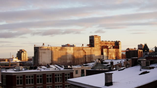 time lapse shot of grain silos in montreal with evening sun fading - vieux montréal stock videos & royalty-free footage