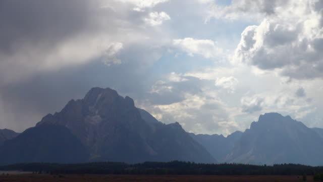 time lapse shot of grand teton national park - mountain range stock videos & royalty-free footage