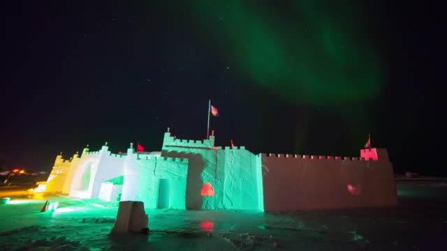 time lapse shot of ice castle at famous park against aurora borealis at night - northwest territories, canada - fast motion stock videos & royalty-free footage