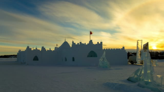 time lapse shot of ice castle at famous park against sky during sunset - northwest territories, canada - fast motion stock videos & royalty-free footage