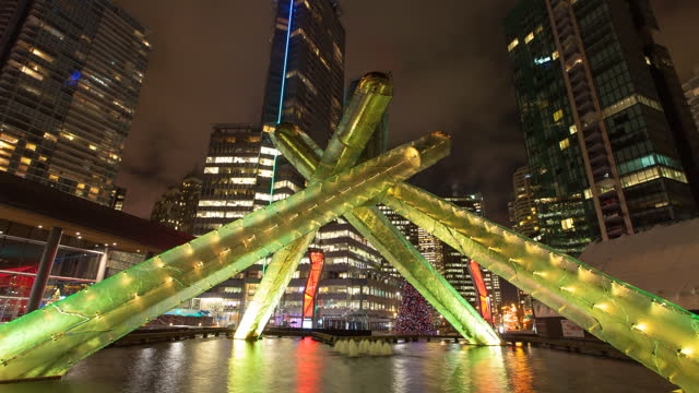 time lapse shot of illuminated olympic cauldron jack poole plaza in city - vancouver, canada - fast motion stock videos & royalty-free footage