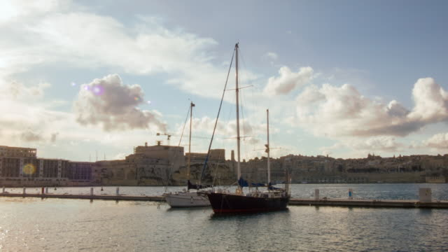 Time lapse shot of moored boats in Valletta's harbour.