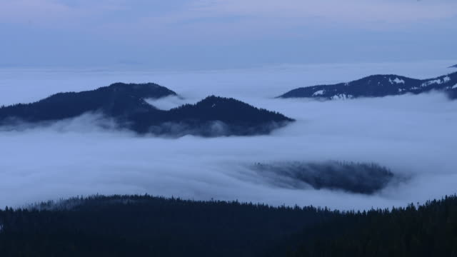 Time lapse shot of mountains amidst clouds at Mt Hood National Forest