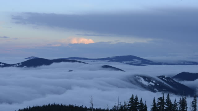 Time lapse shot of mountains amidst cloudscape at Mt Hood National Forest