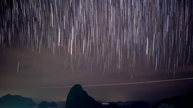 Time lapse shot of Night Sky and Long Star Trail Samet Nang She, Phang-Nga, Thailand