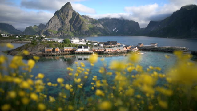time lapse shot of  norwegian fishing village  at the lofoten islands in norway. dramatic sunset clouds moving over steep mountain peaks. - nordland county stock videos & royalty-free footage