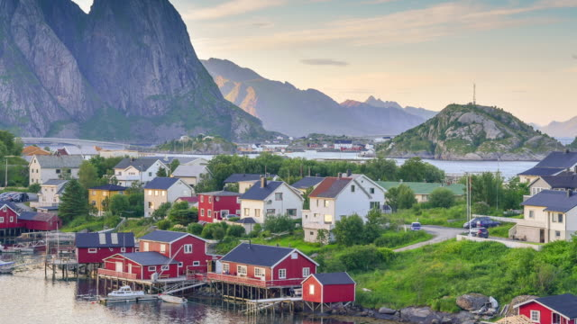 time lapse shot of  norwegian fishing village  at the lofoten islands in norway. dramatic sunset clouds moving over steep mountain peaks. - fishing village stock videos and b-roll footage