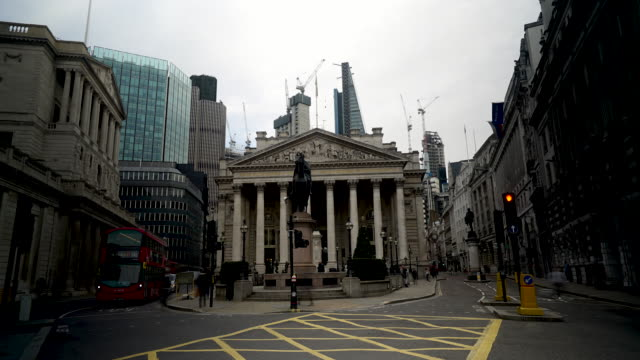 Time lapse shot of pedestrians and traffic moving past the Royal Exchange in the City of London.