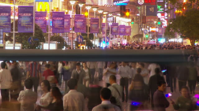 time lapse shot of people along nanjing road in shanghai china - nanjing road stock videos & royalty-free footage