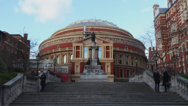 time lapse shot of people walking to and from the royal albert hall in london's south kensington. - royal albert hall stock videos and b-roll footage