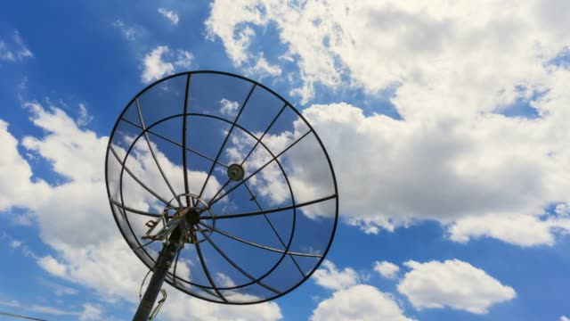 time lapse shot of satellite dish on cloudy sky background - biological process stock videos & royalty-free footage