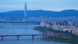 Time lapse shot of Seoul cityscape with Tower, Han River and traffic on expressway at twilight time, South Korea