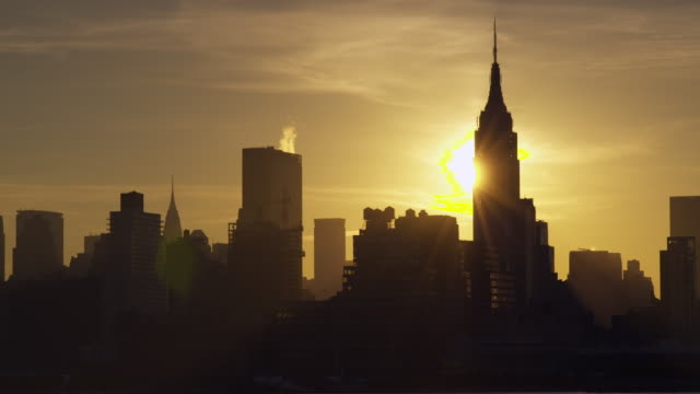 Time Lapse Shot of the sun rising over The Empire State Building in the Manhattan Skyline in New York City.