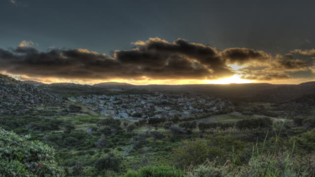 time lapse shot of the sun setting over cape town and the surrounding countryside. - orange colour stock videos & royalty-free footage