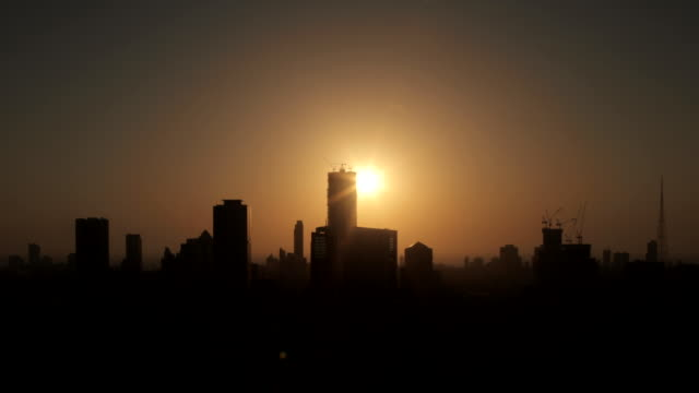 time lapse shot of the sun setting over the city of mumbai. - skyline stock videos & royalty-free footage