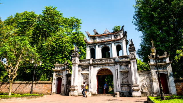 time lapse shot of tourists in front of temple of literature main gate. hanoi, vietnam - public building stock videos and b-roll footage