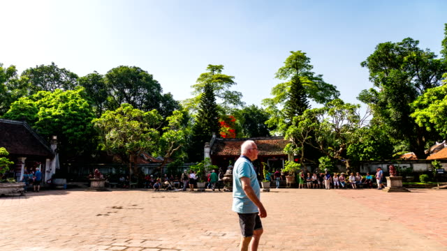 time lapse shot of tourists walking in ancient temple . hanoi, vietnam - public building stock videos and b-roll footage