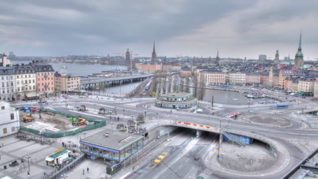 Time lapse shot of traffic moving along roads in the Sodermalm district of Stockholm.