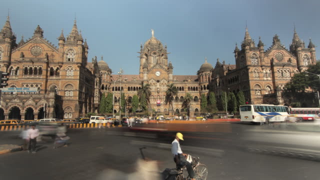 time lapse shot of traffic moving past chhatrapati shivaji terminus railway station in mumbai. - famous place stock videos & royalty-free footage