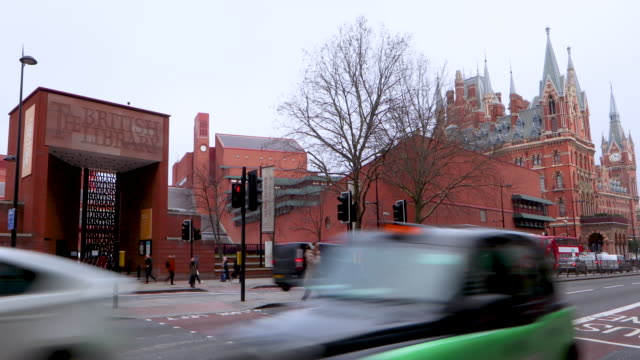 Time lapse shot of traffic moving past the British Library on London's Euston Road.
