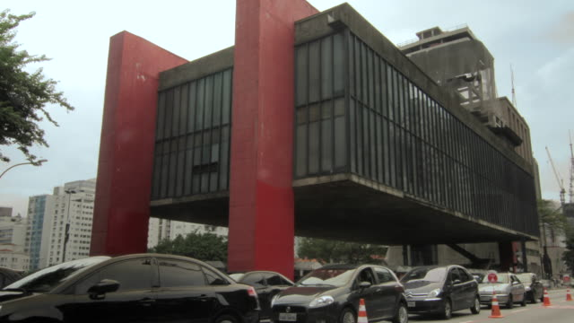 Time lapse shot of traffic moving past the Sao Paulo Museum of Art.