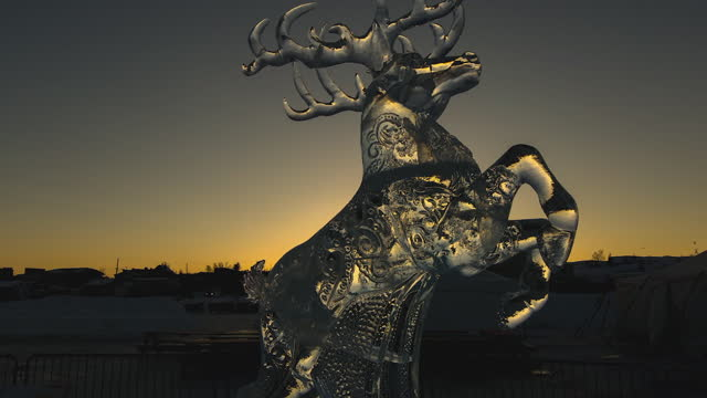 time lapse shot of transparent ice statue against clear sky during sunset - british columbia, canada - fast motion stock videos & royalty-free footage