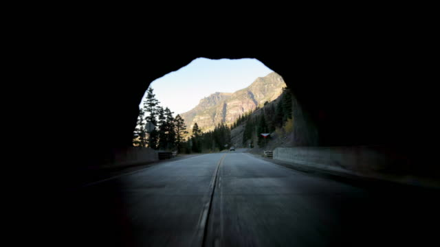 pov time lapse shot of vehicles passing through tunnel on mountain road against sky - million dollar highway, colorado - mountain road stock videos & royalty-free footage