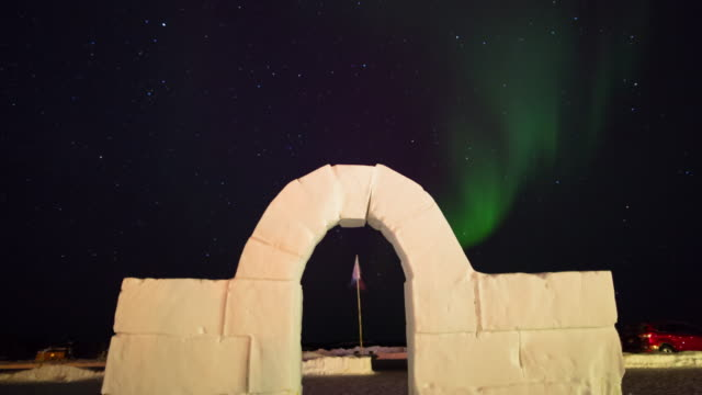 time lapse shot of white arch entrance at park against polar lights during night - northwest territories, canada - fast motion stock videos & royalty-free footage