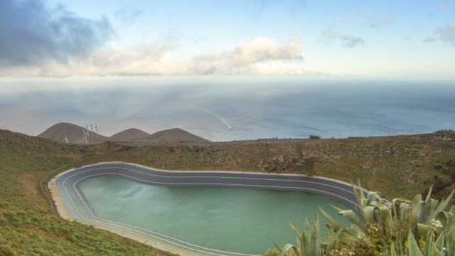 Time lapse shot over a half filled reservoir on the island of El Hierro.