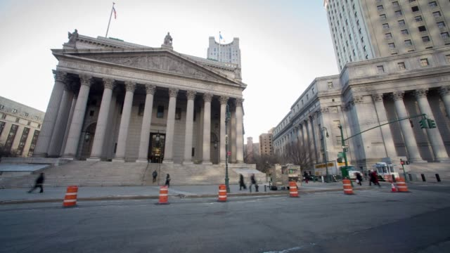 Time lapse shots of the State Supreme Court at 60 Centre Street in Manhattan New York US Sunlight moves across the facade above the columns lining...