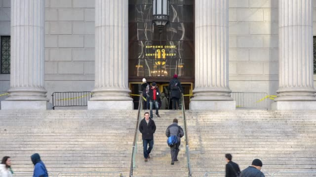Time lapse shots of the State Supreme Court at 60 Centre Street in Manhattan New York US Sunlight moves across the façade above the columns lining...