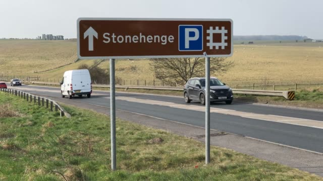 Time lapse showing traffic passing along the busy A303 that runs besides the ancient neolithic monument of at Stonehenge on February 22 2018 in...