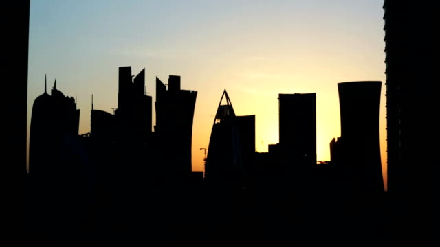 time lapse silhouette of modern city sunset - doha stock videos & royalty-free footage