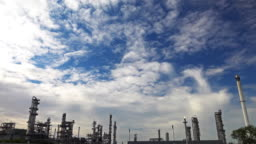 4K Time lapse sky and cloud over the oil refinery plant.