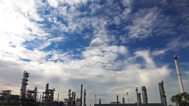 4k time lapse sky and cloud over the oil refinery plant. - power supply stock videos & royalty-free footage