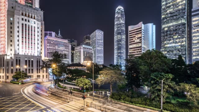 time lapse - skyscrapers and night traffic in hong kong - central district hong kong stock videos & royalty-free footage