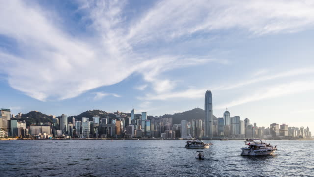 time lapse - skyscrapers in hong kong (zoom in) - victoria harbour hong kong stock videos & royalty-free footage