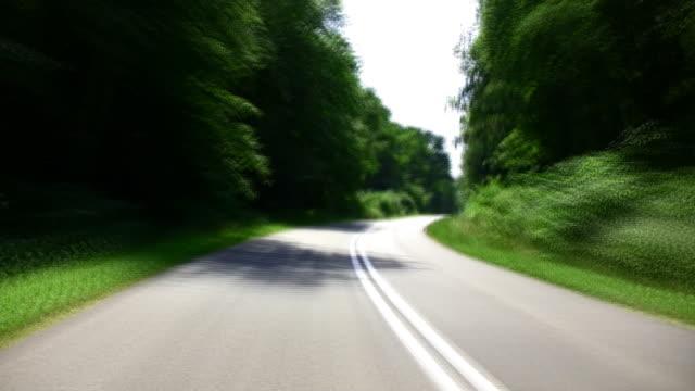 タイムラプス-高速の street - 乗物後部から見た視点点の映像素材/bロール